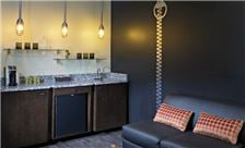 ACME Hotel Company, Illinois - King Suite Living Room With Bar