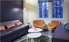 ACME Hotel Company, Illinois - King Suite Living Room With Windows
